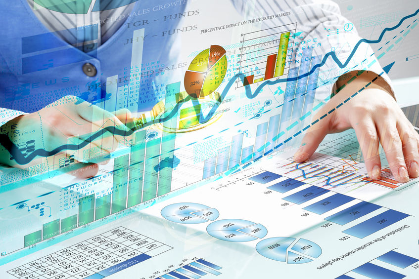 49145516 - close up of business person investigating infographs with magnifier