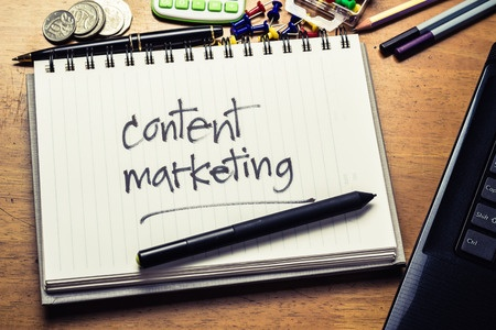 Content advetising and marketing written on a notepad